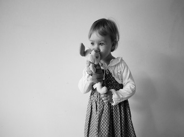 female child with a stuffed animal
